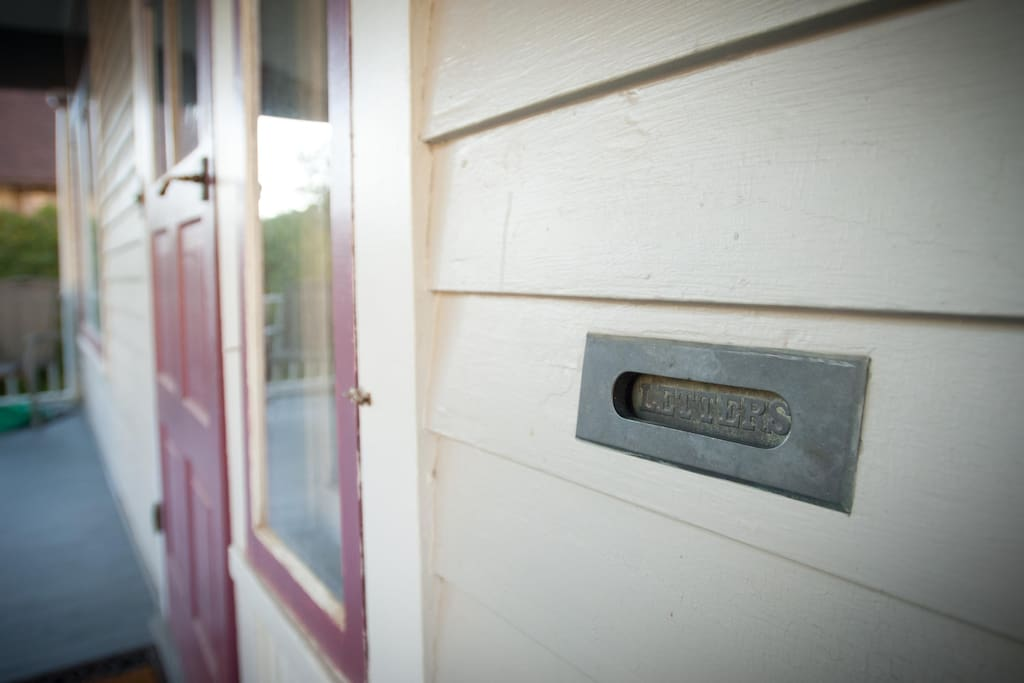 The house has a lot of original hardware, like this pretty rockin' mail slot.