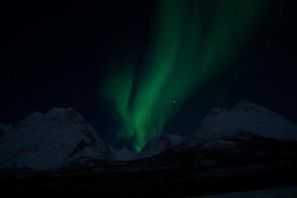 The northen light seen outside the cabin