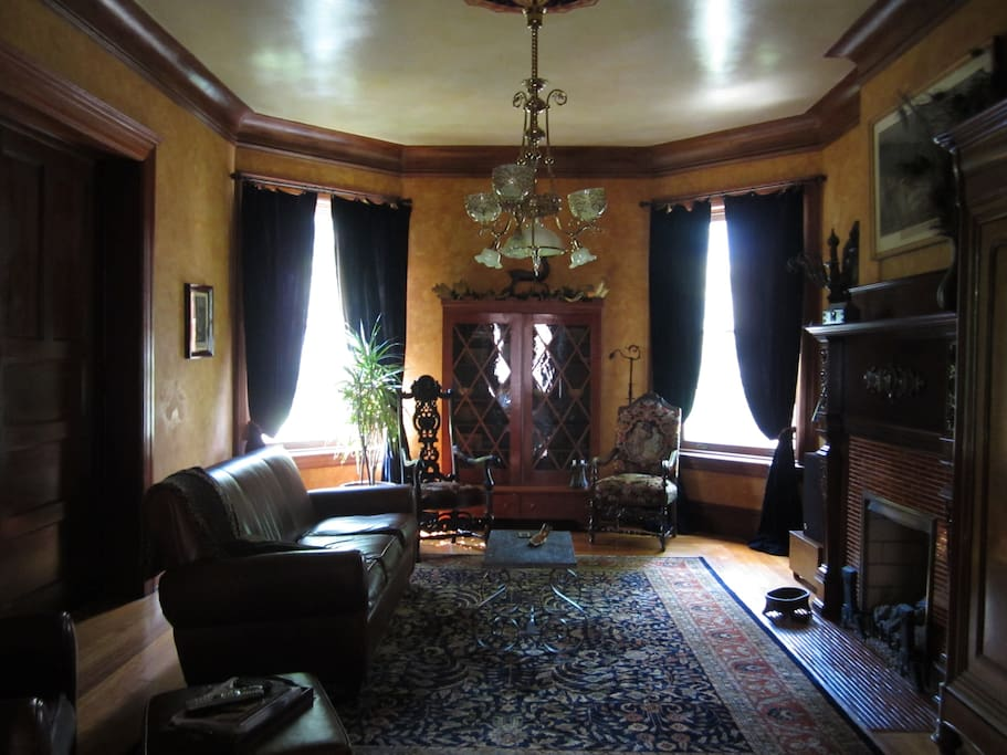 Living room with one of 12 original chandeliers