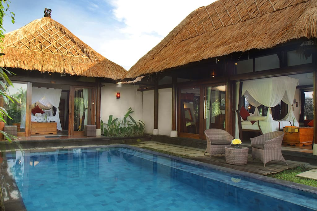 Villa Ananda (left) shares a pool with Villa Ananda Sri (right)