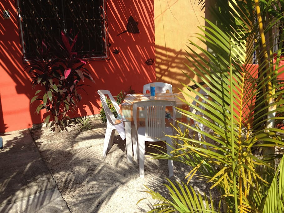 Your place for shady outdoor dining and relaxing, day or evening.