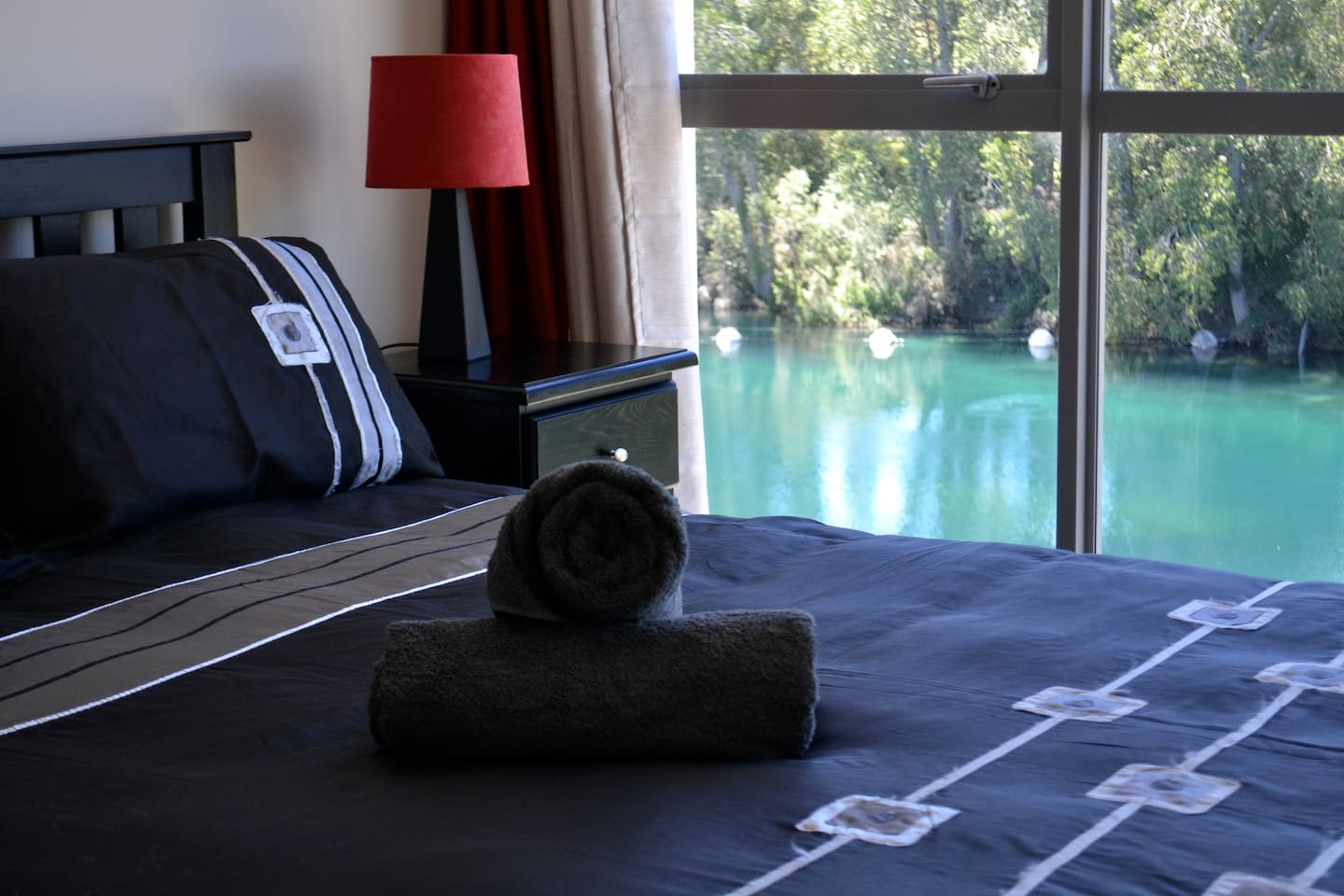 Wake to the tranquil views of the Waikato River from the Master suite