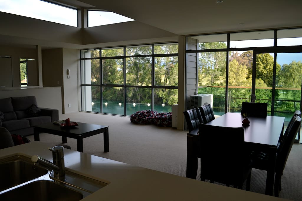 Enjoy expansive views of the river and Lake Taupo Marina from all parts of the living area