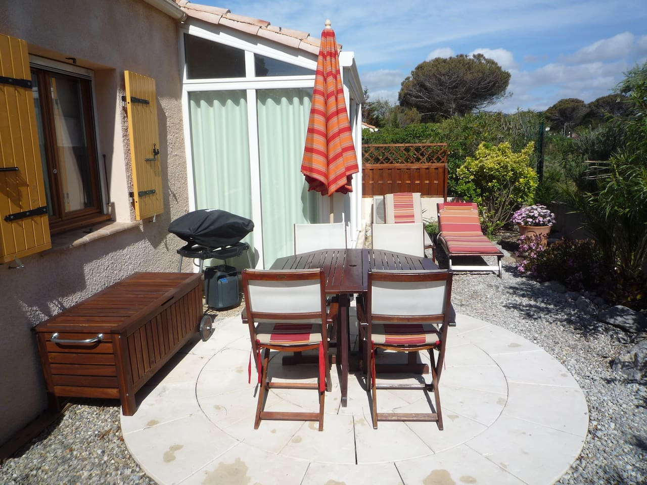 Terrace, outdoor dining space and gas bbq in the secluded back garden.