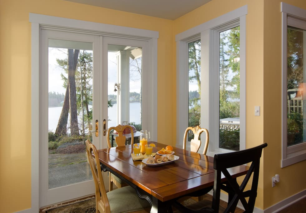 Dining space seats six with beautiful view of gardens and beach.