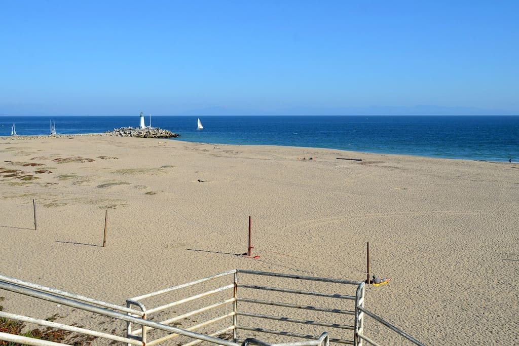 Watch the sailboats at the end of the street--we are the 3rd lot from the sand.