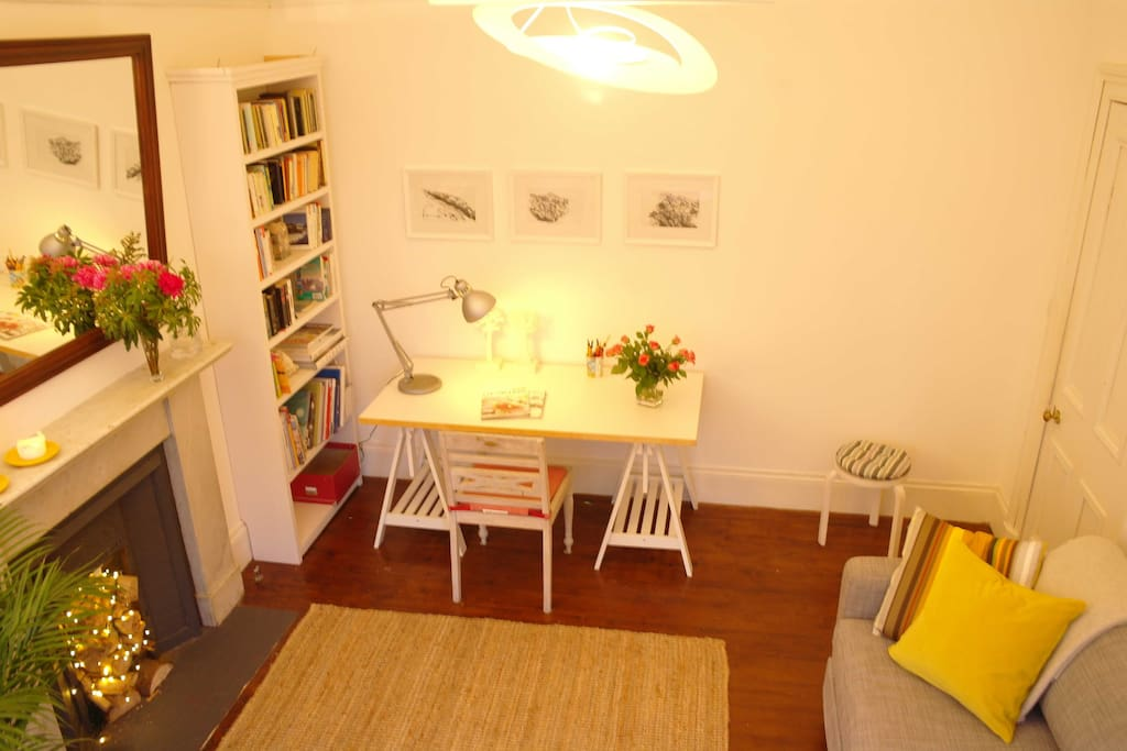 Living room with writing desk to get those postcards done!
