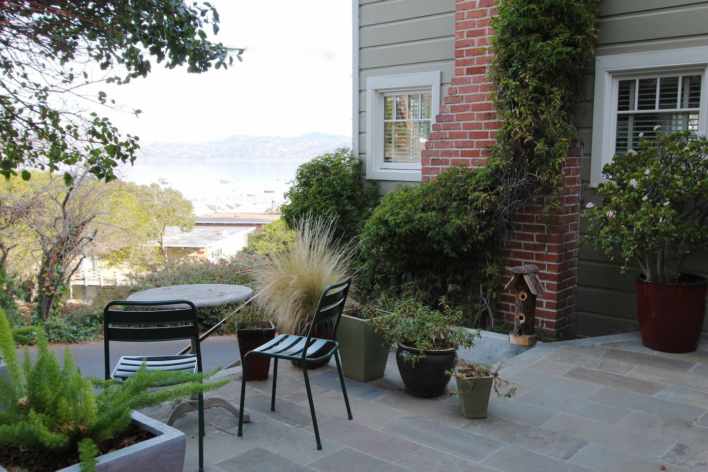 Sitting area out side cottage with views of the bay