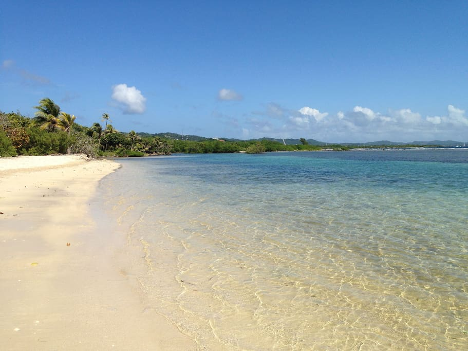 Private white sand beach with snorkeling reef closeby