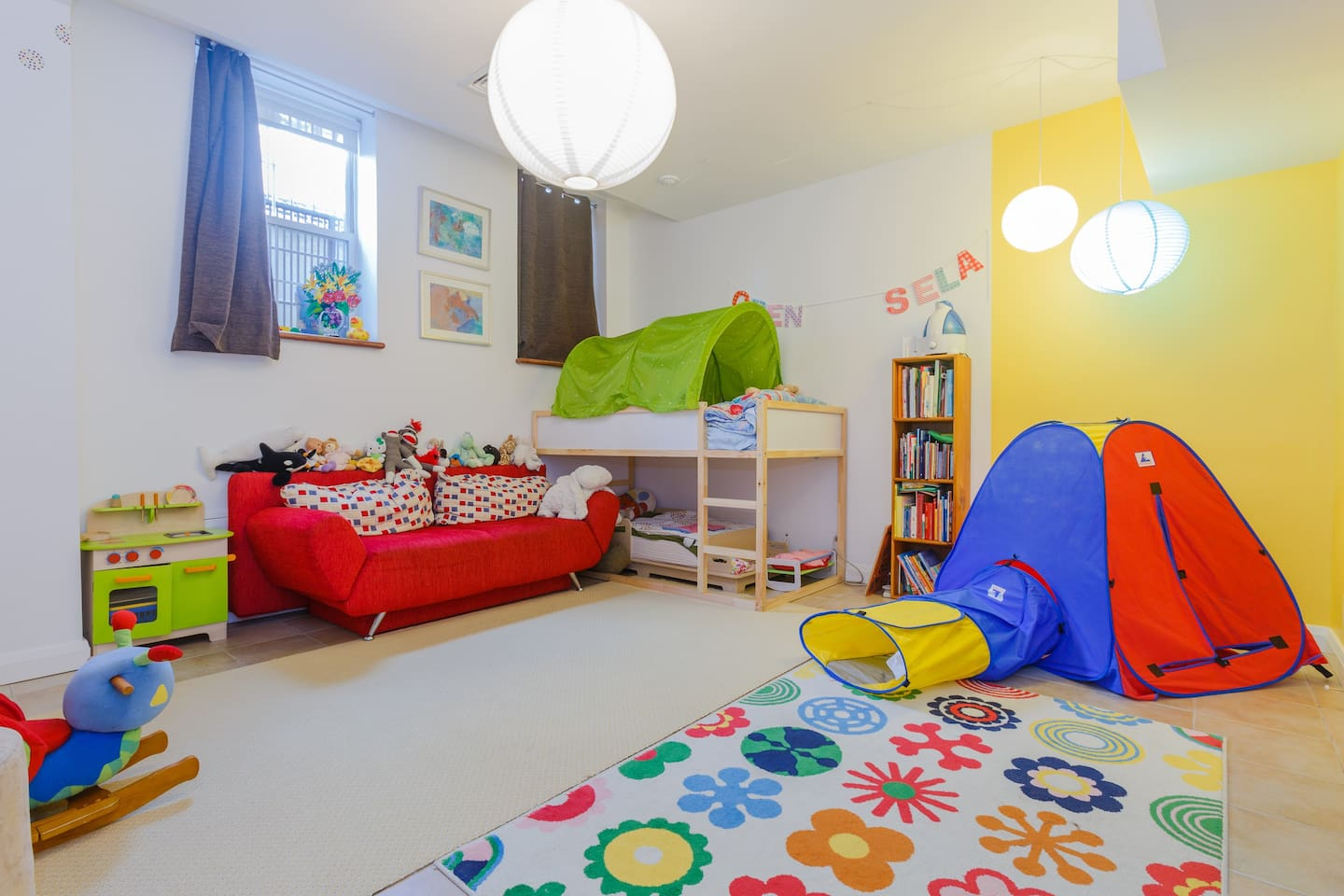 Fun kids room with twin and toddler bed and fold-out couch.