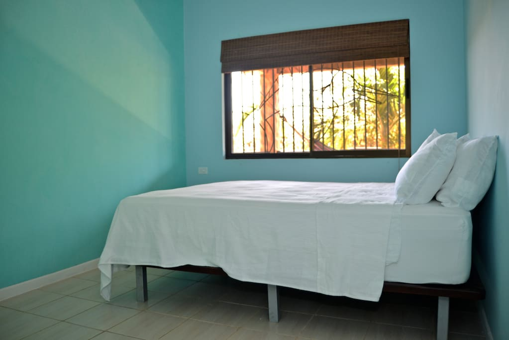 Guest bedroom with queen pillow top mattress and AC