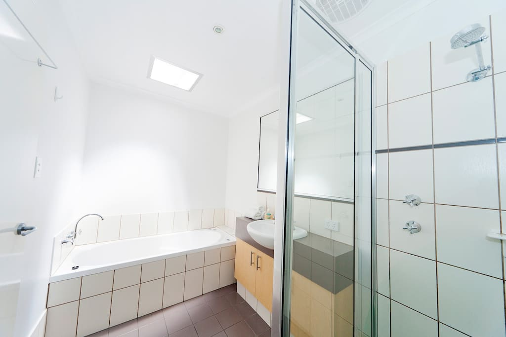 Ensuite bathroom with spa bath and separate shower and toilet.