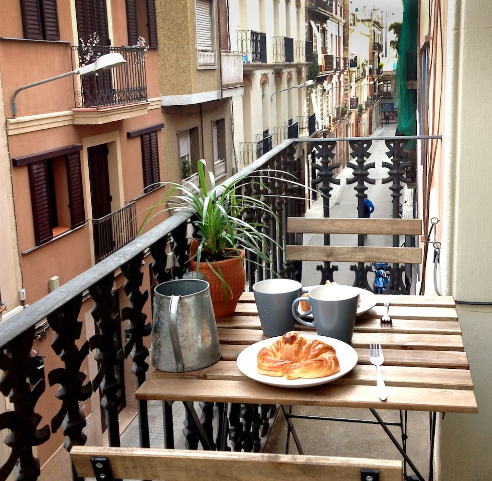 Small balcony to enjoy a good breakfast in a quiet street.