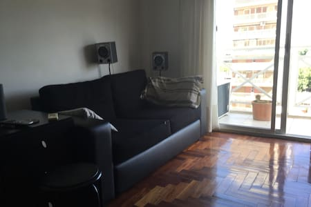Cozy living room with couch - Apartment