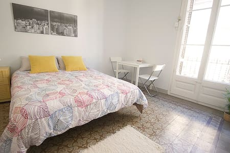 Double, bright and spacious room with a private terrace. In a classic floor with mosaic floors and high ceilings.  Located in the old city center: El Born Easy walk to the city`s best musseum, parks, cathedrals, beach, and other attractions.