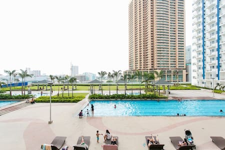 Your Best 1BR CityCenter Staycation - Mandaluyong