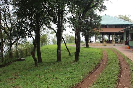 Stilt house Nestled on a Mountain at Sathram - Villa