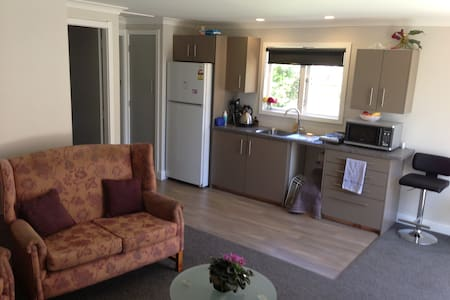 This lovely self contained modern unit is newly renovated and features an open plan kitchen & lounge area, it has a separate bedroom with a Queen bed. This unit is fully insulated plus has 2 x echo wall heaters to keep you warm & cosy.