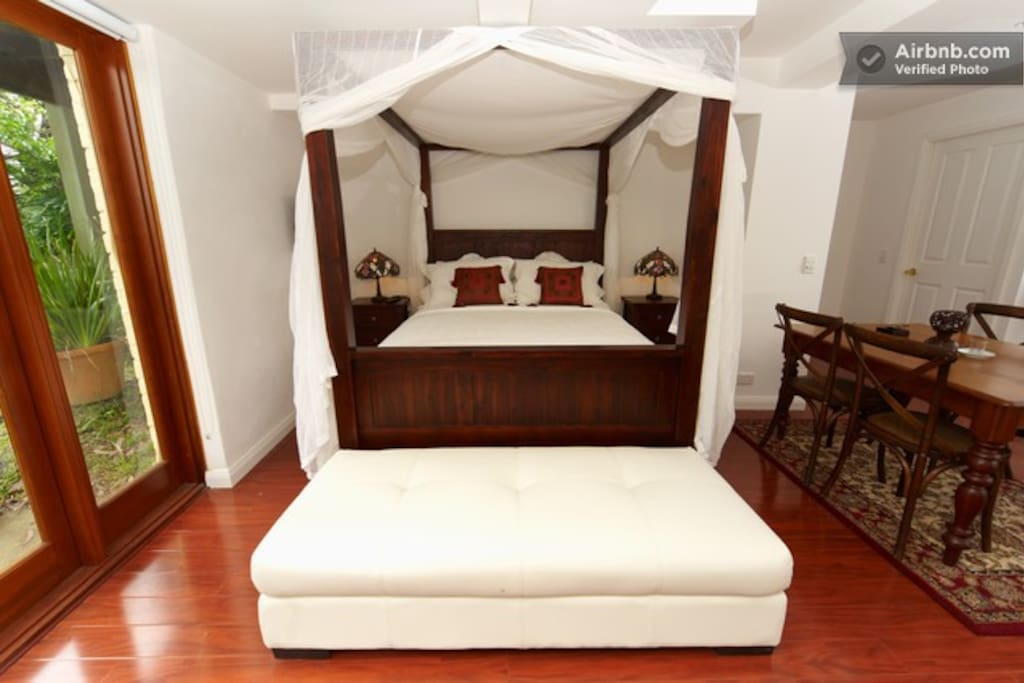 Romantic '4 Poster Bed' with sheer white canopy to snuggle up especially on those cold rainy days ..