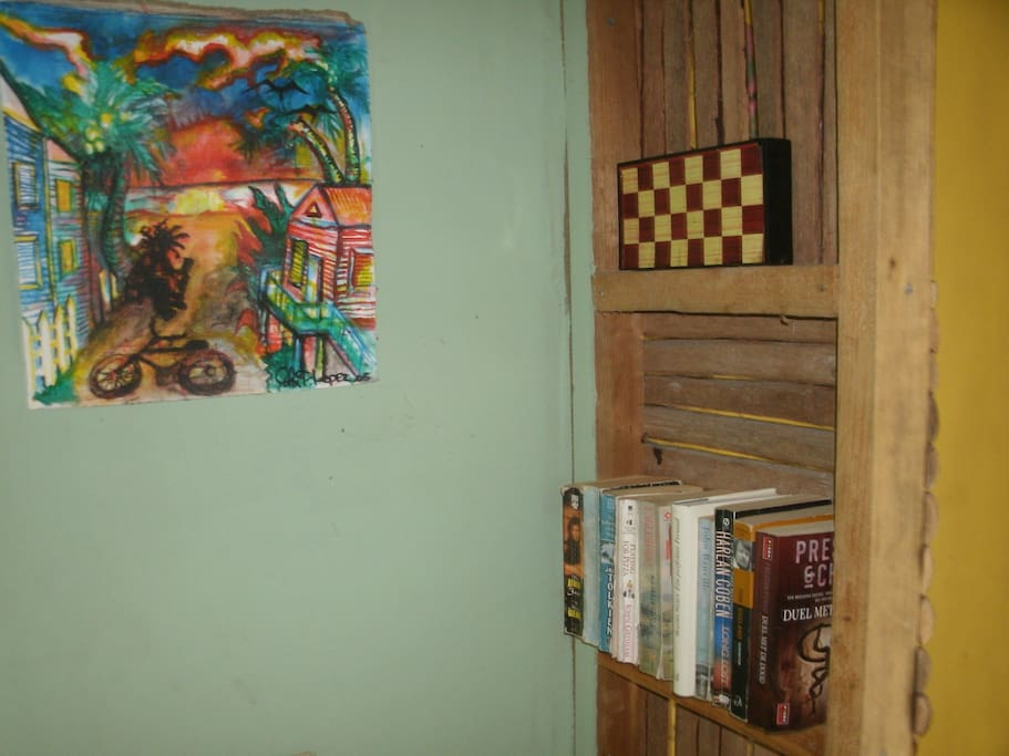 there are books, games and local art in the cabana