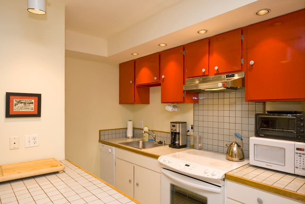 Fully equipped kitchen has all new appliances, including a dishwasher and disposal & sharp knives and gourmet cookware.