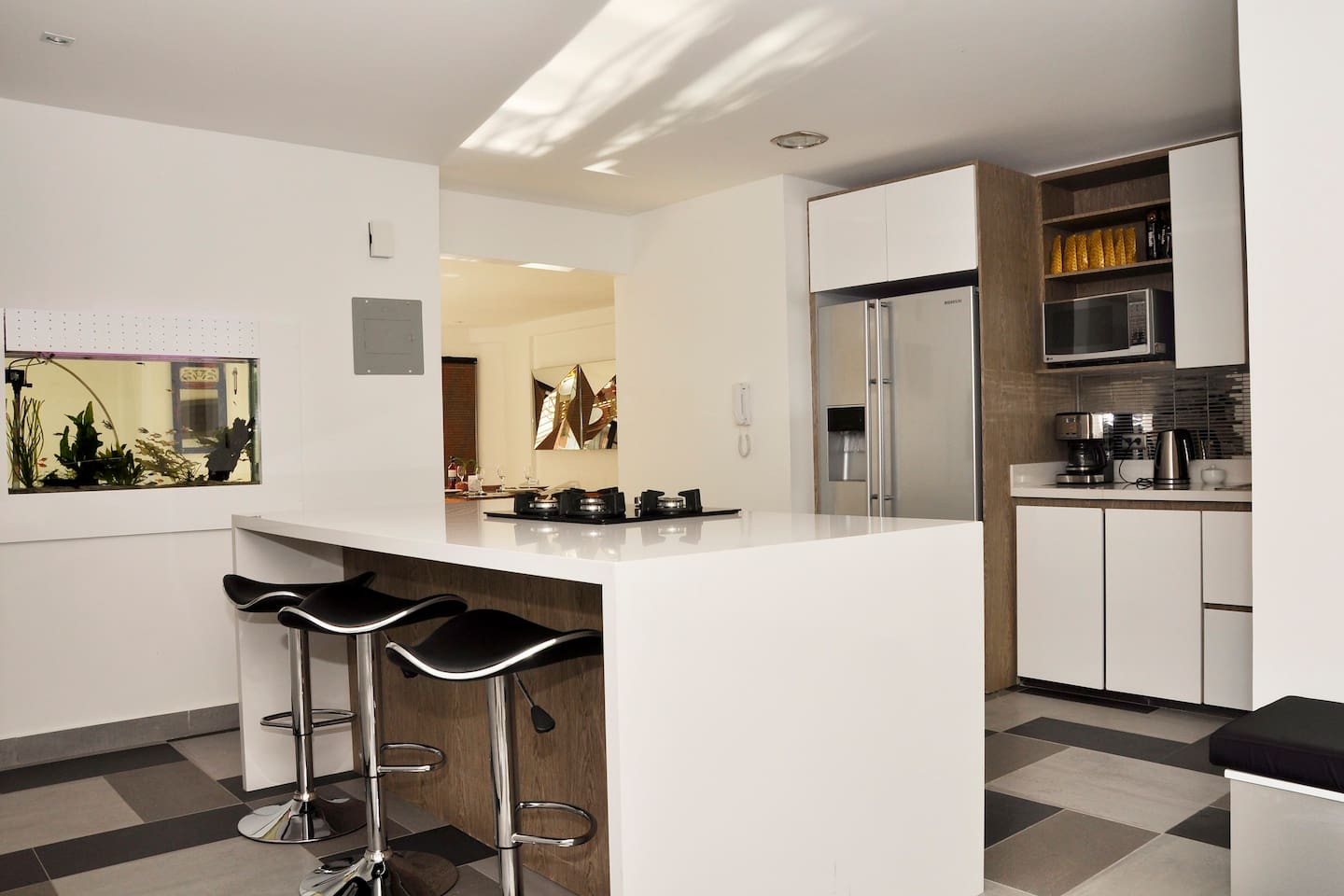 Kitchen with cooking island and breakfast bar