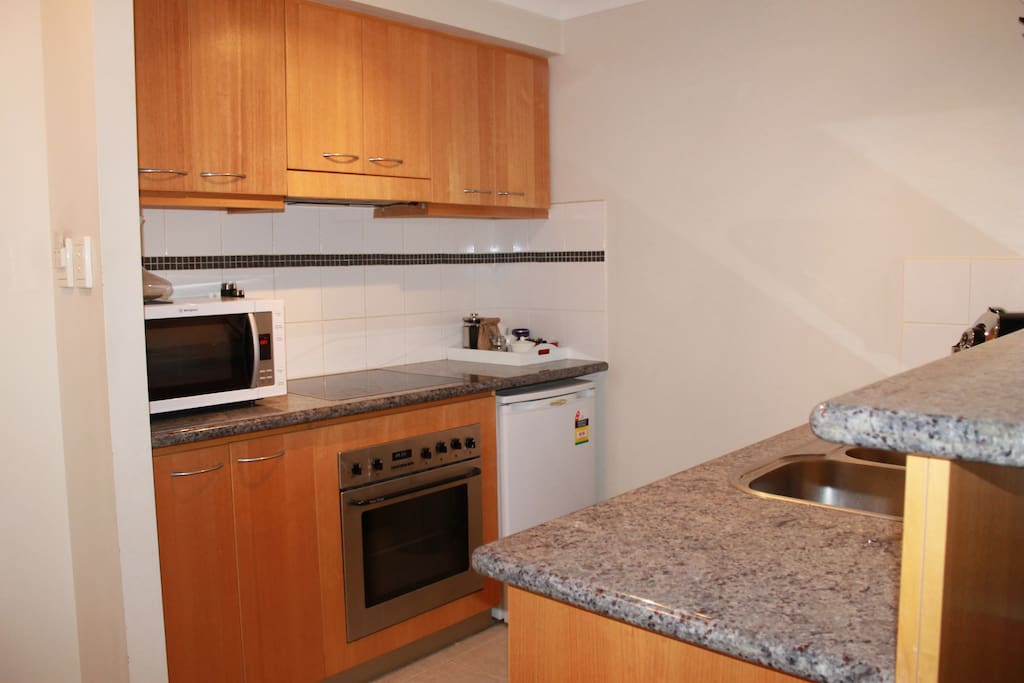 Full kitchen with dishwasher, fridge, oven, microwave, tea/coffee facilities.