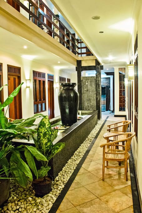 Ground floor of Kuta EcoStay with the carp pond and guestrooms