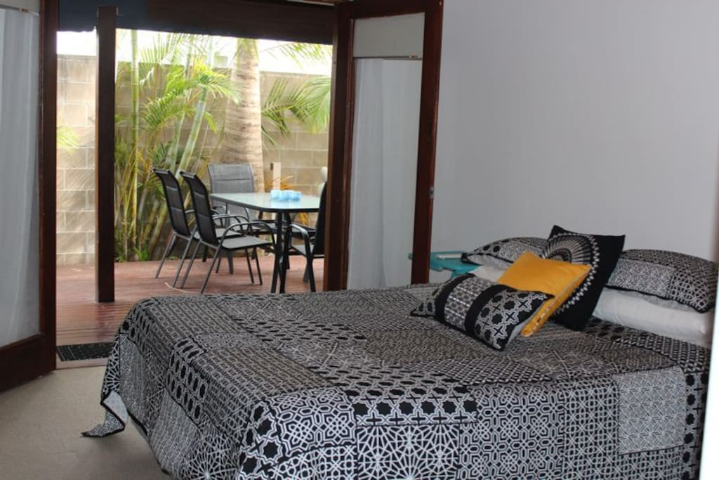 Main Bedroom with king bed and double doors onto deck