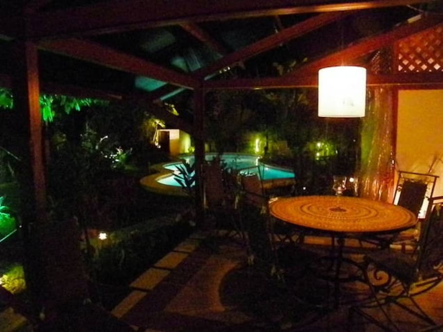 Lit up at night, the inside/outside living area is the perfect place for dinner!