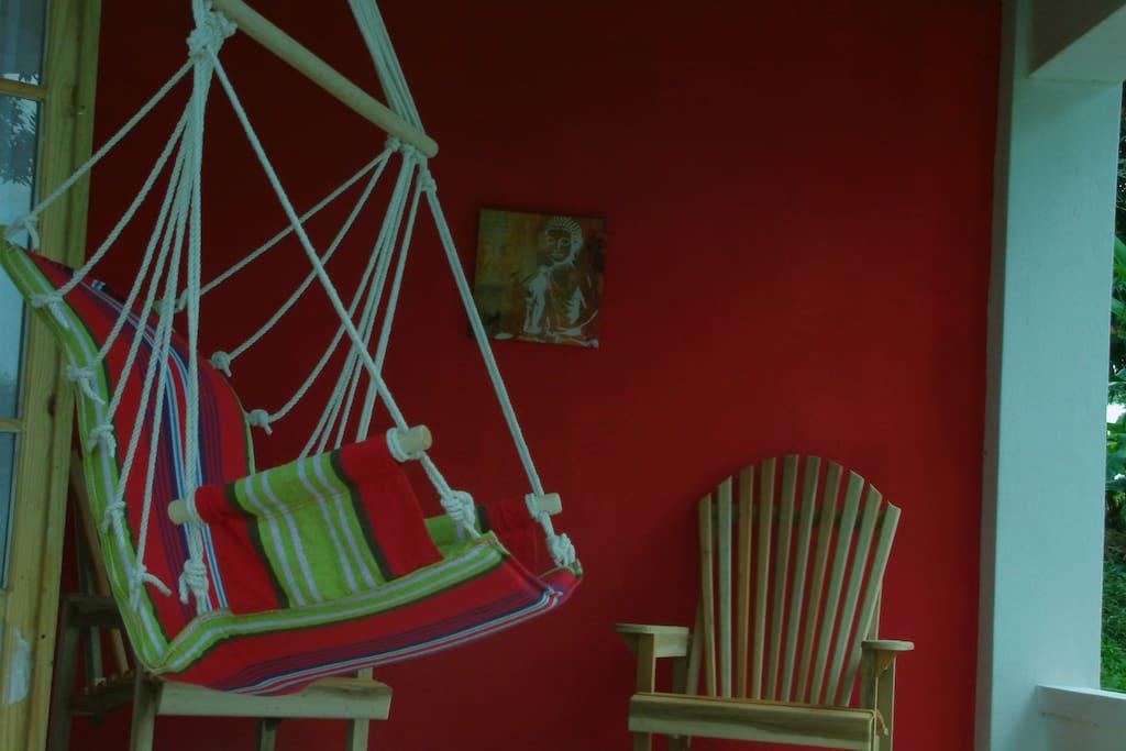 veranda with hammock chair with mountain views