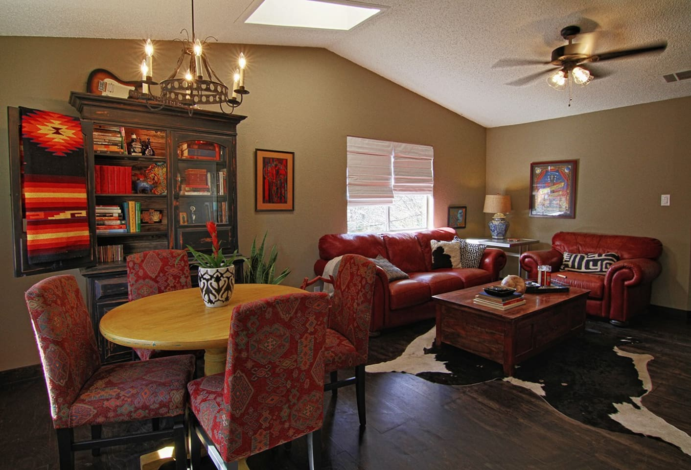 Plenty of space in the open living/diningwith vaulted ceilings and skylight.
