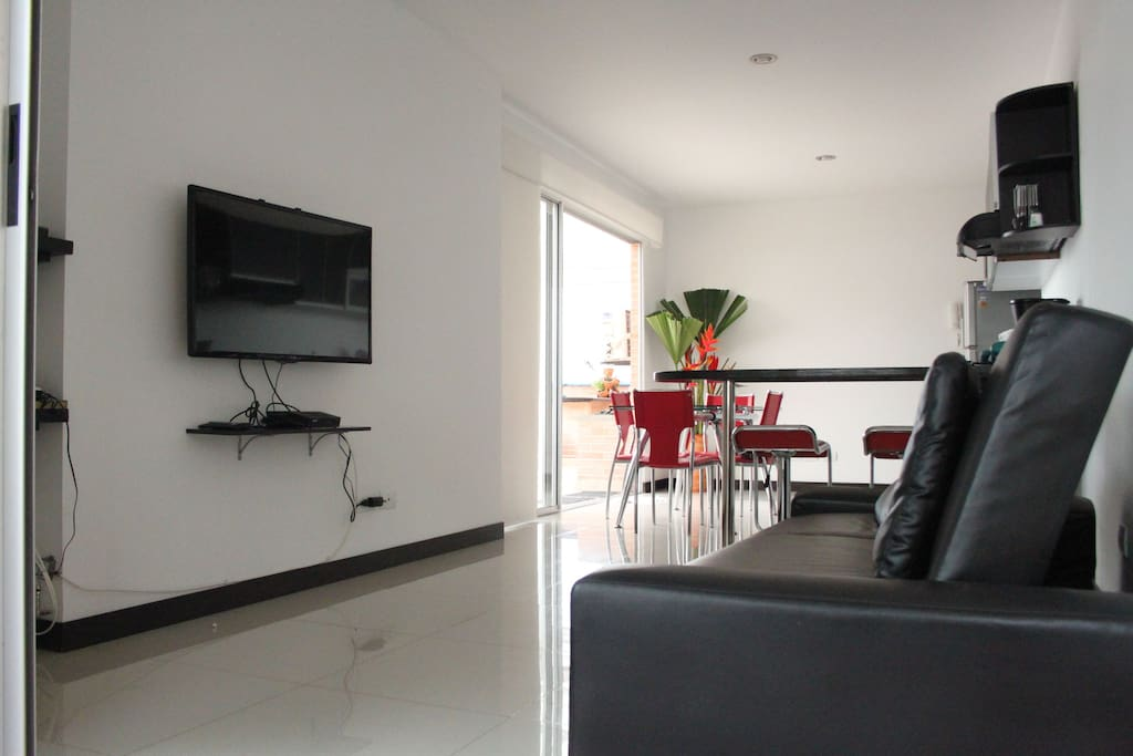 Our open plan kitchen and living area get lots of light, and you get a lovely breeze circulating through the whole apartment.