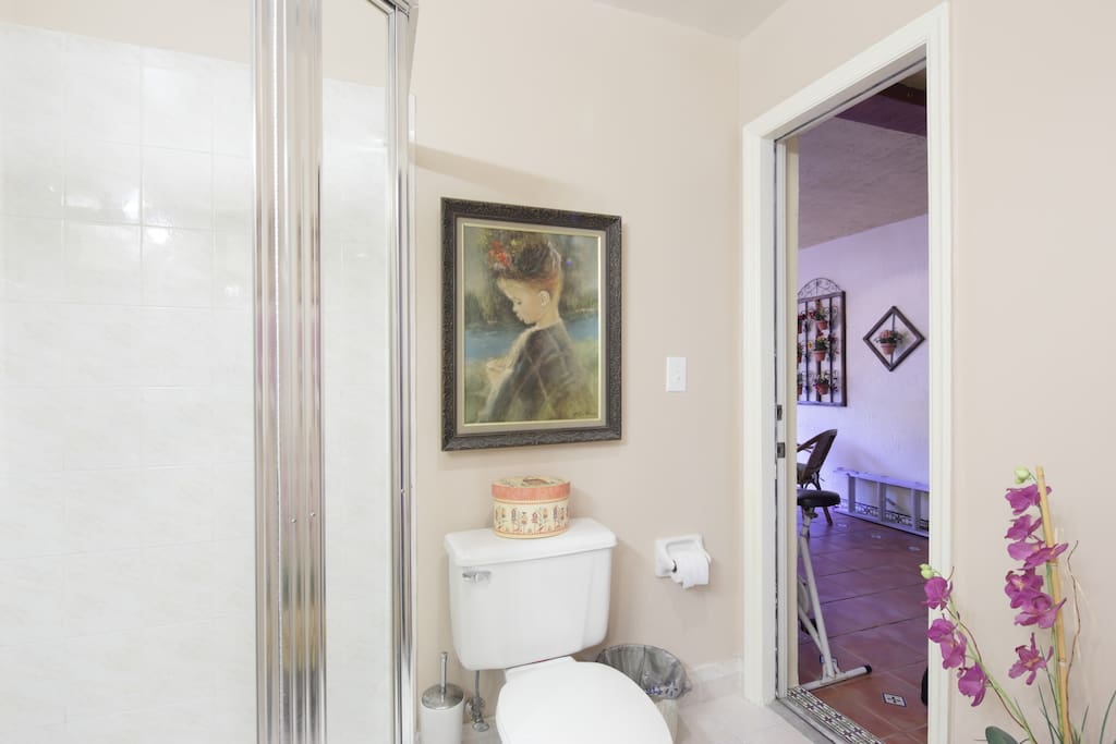 Your Private Bathroom downstairs leads to outside covered patio