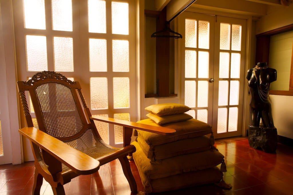 An Ilocano butaka chair. The doors exit onto the covered patio