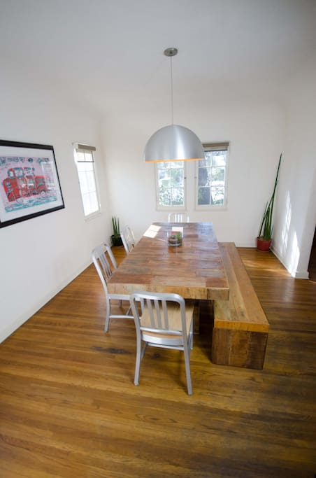 Gourgeous dining room with reclaimed wood family style table that can double as conference table. Seats 7, connected to kitchen and living room.