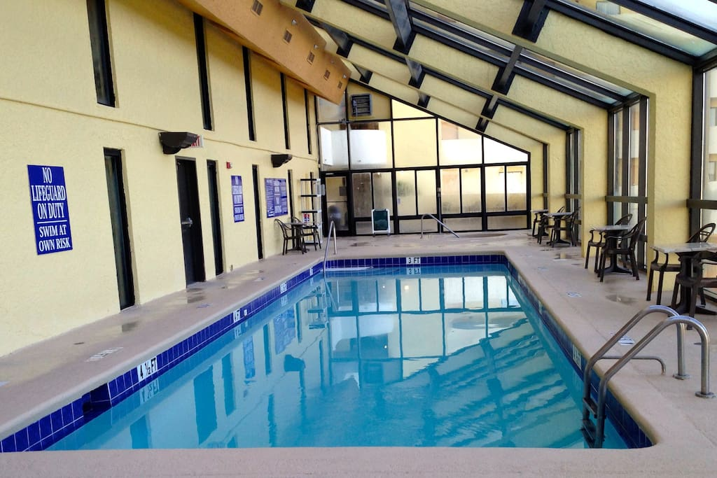 Great Greenhouse Style Indoor Pool with Hot Tubs and City Views from the 7th Floor