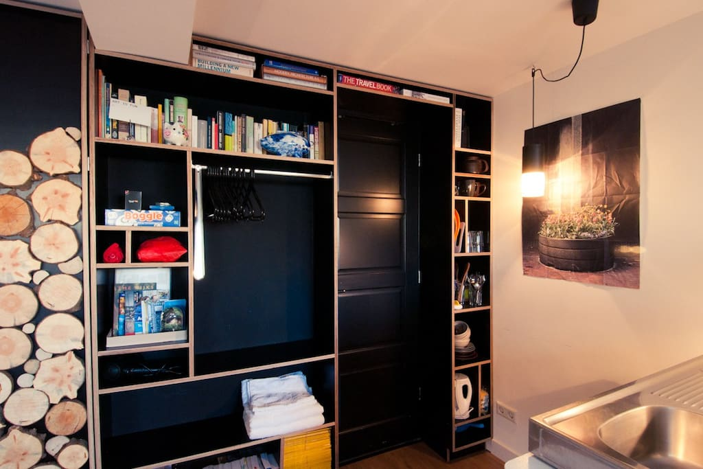 cabinet with plenty of space & travel guides