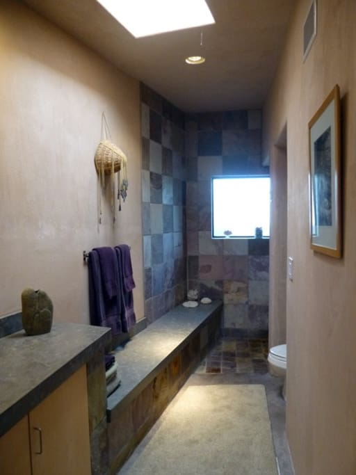 Spacious shower, thick Turkish towels, and eco-conscious toiletries make the bathroom a worthy experience.