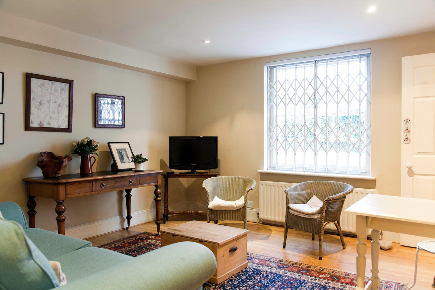 sitting room with television and writing desk