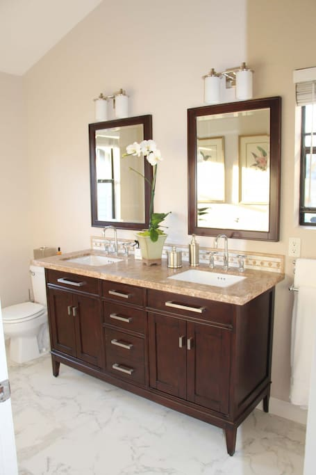 All new marble top vanity, tile, and plush new towels!