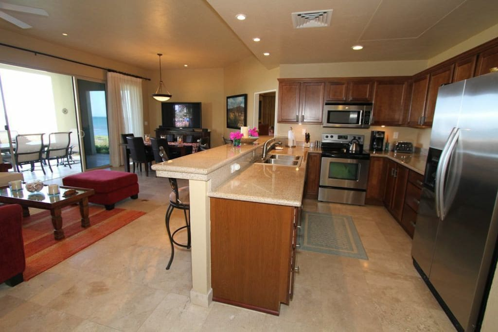Large kitchen, dining area and large screen tv