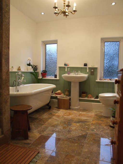 A modern fully equipped bathroom which includes a shower cubicle, and luxury underfloor heating