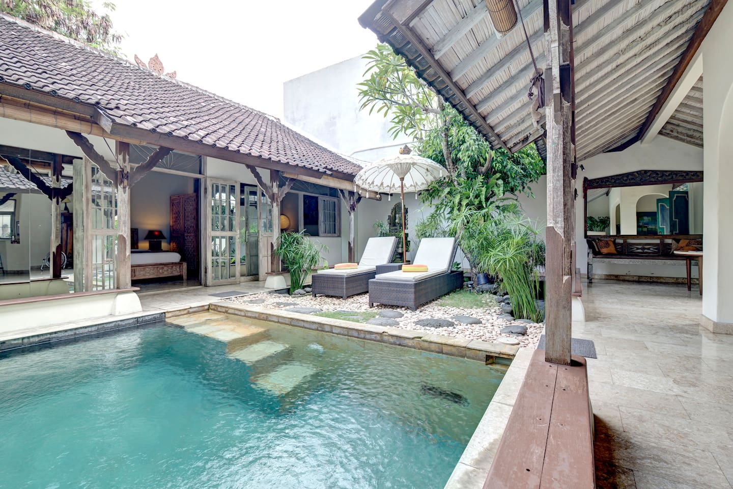 Atrium Style House  built around the pool