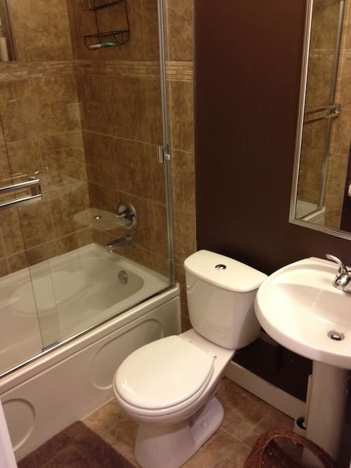 Shared bathroom with tub/shower.
