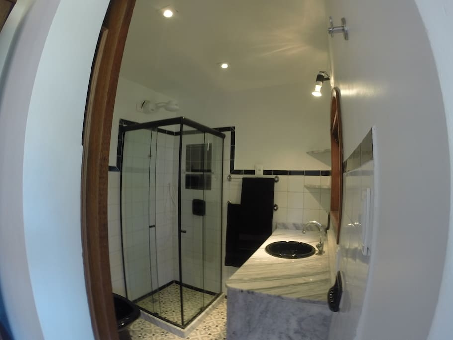 From the bedroom you walk into the BATHROOM with a shower...