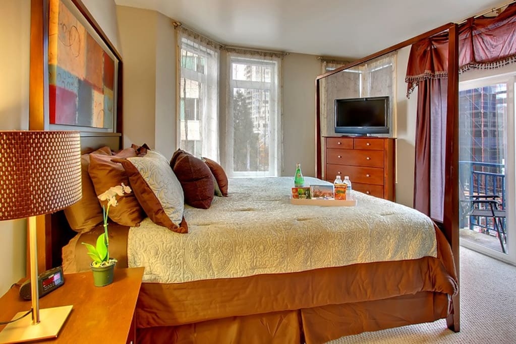 Master bedroom with king sized bed and glimpse of Elliot Bay