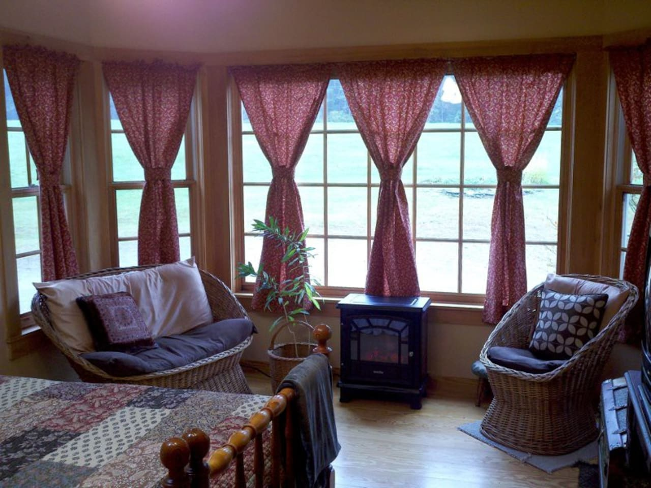 The Maple room with king size bed, huge bay window with meadow views and small sitting area.