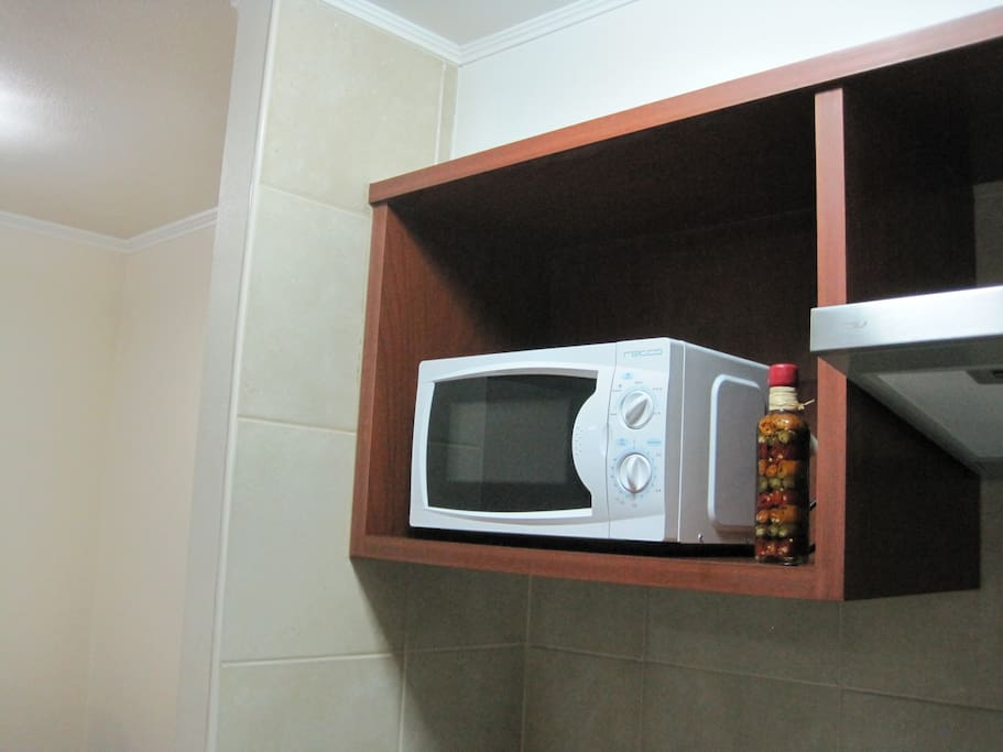 Kitchen with microwave oven.