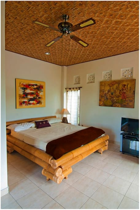King size bamboo bed with with pillow-top mattress.